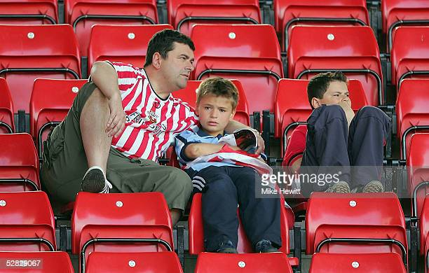 Dejected Southampton fans after seeing their team relegated from the Premiership after the Barclays Premiership match between Southampton and...