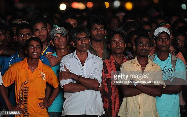 Dejected Sri lankan cricket fans watch a telecast of the Cricket World Cup final match between Sri Lanka and India in Colombo on April 2 2011 India...