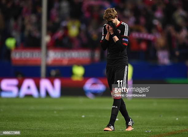 A dejected Stephan Kiessling of Bayer Leverkusen holds his head after missing a penalty in the shoot out during the UEFA Champions League round of 16...