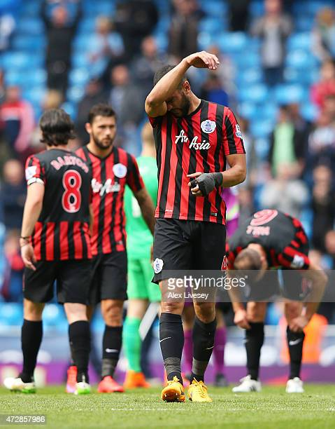 A dejected Steven Caulker of QPR and teammates react following their team's relegation during the Barclays Premier League match between Manchester...