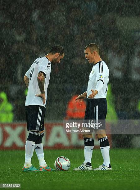 A dejected Steven Fletcher and Kenny Miller of Scotland after Wales scored the winning goal
