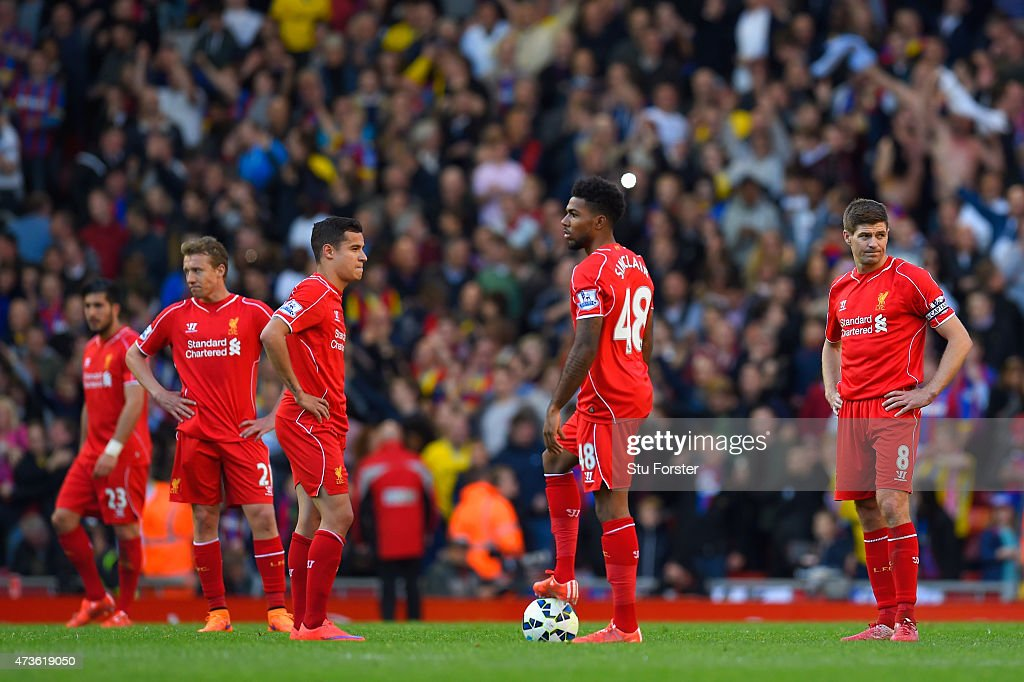 A dejected Steven Gerrard of Liverpool (R) looks on after Liverpool conceded a third goal during the Barclays Premier League match between Liverpool and Crystal Palace at Anfield on May 16, 2015 in Liverpool, England.