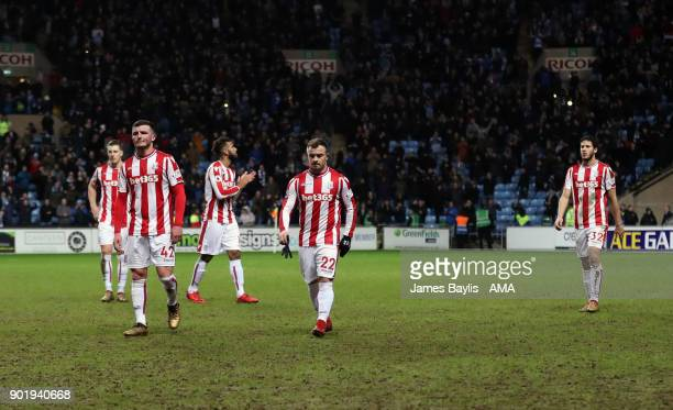 Dejected Stoke City players leave the pitch at full time after The Emirates FA Cup Third match between Coventry City and Stoke City at Ricoh Arena on...