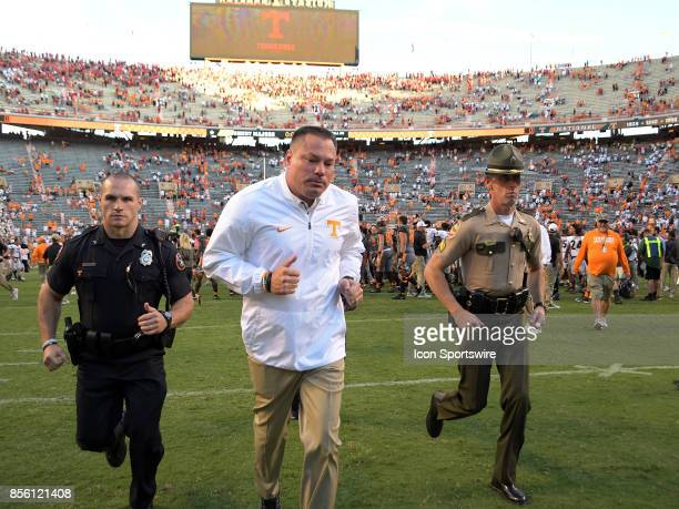 A dejected Tennessee Vols Head Coach Butch Jones runs off the field after the game between the Georgia Bulldogs and the Tennessee Volunteers on...
