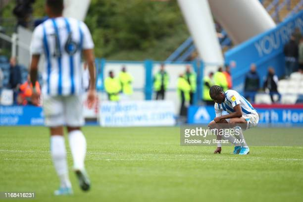 Dejected Terence Kongolo of Huddersfield Town reacts at full time during the Sky Bet Championship match between Huddersfield Town and Sheffield...