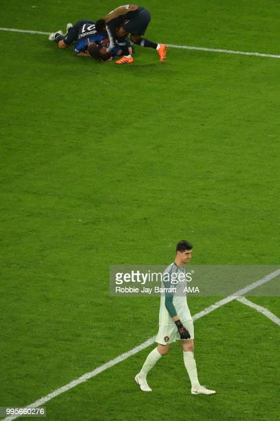 A dejected Thibaut Courtois of Belgium at full time as France celebrate making the World Cup Final during the 2018 FIFA World Cup Russia Semi Final...