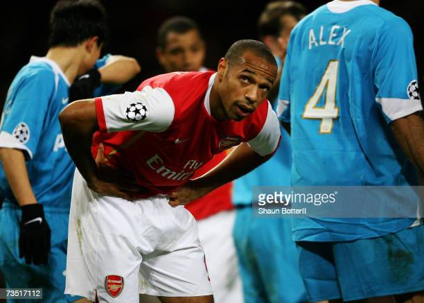 A dejected Thierry Henry of Arsenal looks on as the final whistle blows during the UEFA Champions League round of sixteen second leg match between...