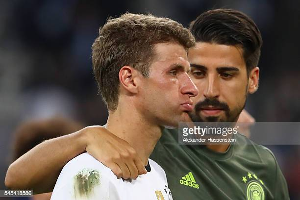 Dejected Thomas Mueller of Germany is consoled by Sami Khedira after defeat in the UEFA EURO 2016 semi final match between Germany and France at...
