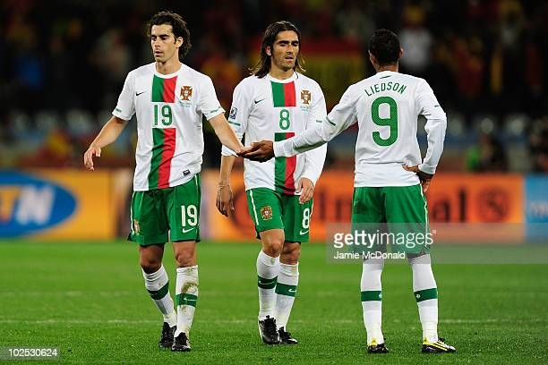Dejected Tiago, Pedro Mendes and Liedson of Portugal after being knocked out of the tournament during the 2010 FIFA World Cup South Africa Round of...