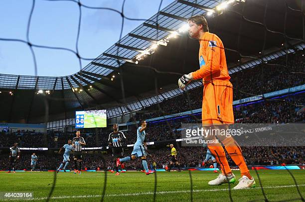 A dejected Tim Krul of Newcastle United looks on as Sergio Aguero of Manchester City turns to celebrate scoring the opening goal from the penalty...