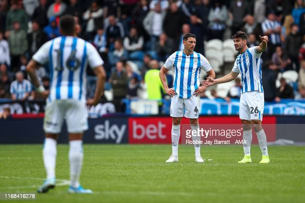 A dejected Tommy Elphick of Huddersfield Town and Christopher Schindler of Huddersfield Town react during the Sky Bet Championship match between...