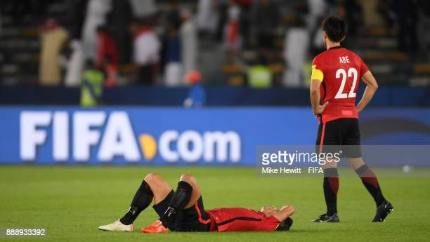 A dejected Tomoaki Makino and Yuki Abe of Urawa Reds can't hide their disappointment after suffering defeat in the FIFA Club World Cup UAE 2017...