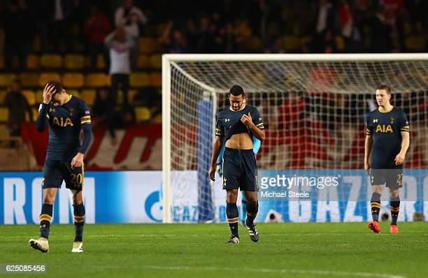 Dejected Tottenham Hotspur players react after conceding their second goal during the UEFA Champions League Group E match between AS Monaco FC and...