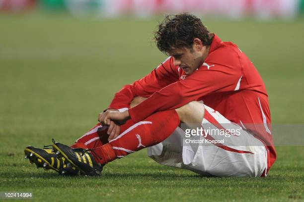 Dejected Tranquillo Barnetta of Switzerland after a goalless draw and elimination from the tournament during the 2010 FIFA World Cup South Africa...
