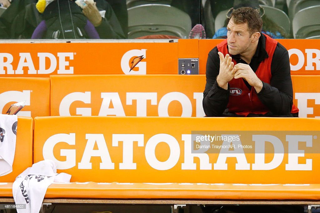 A dejected Travis Cloke of the Magpies sits on the bench at 3/4 time with an injury during the round 16 AFL match between the Collingwood Magpies and the West Coast Eagles at Etihad Stadium on July 18, 2015 in Melbourne, Australia.