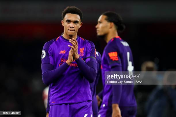 A dejected Trent AlexanderArnold of Liverpool applauds the fans at full time during the Premier League match between Arsenal FC and Liverpool FC at...