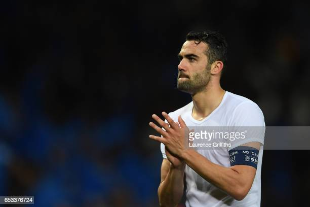 A dejected Vicente Iborra of Sevilla walks off the pitch following his team's 32 agg defeat during the UEFA Champions League Round of 16 second leg...