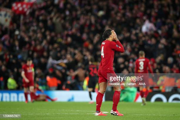Dejected Virgil Van Dijk of Liverpool after defeat in the UEFA Champions League round of 16 second leg match between Liverpool FC and Atletico Madrid...