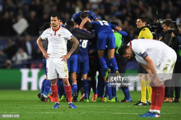 A dejected Vitolo of Sevilla looks on as Leicester players celebrate their 32 agg victory during the UEFA Champions League Round of 16 second leg...