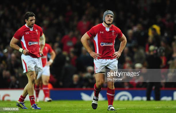 Dejected Wales players Alex Cuthbert and Jonathan Davies look on during the International Match between Wales and New Zealand at Millennium Stadium...