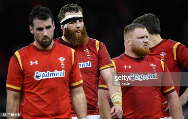 Dejected Wales players including Jake Ball leave the field after the RBS Six Nations match between Wales and England at Principality Stadium on...