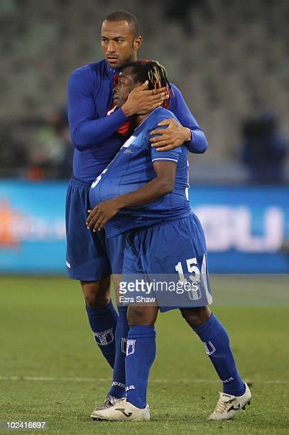Dejected Walter Martinez of Honduras is consoled by team mate Victor Bernardez after a goalless draw and elimination from the tournament during the...