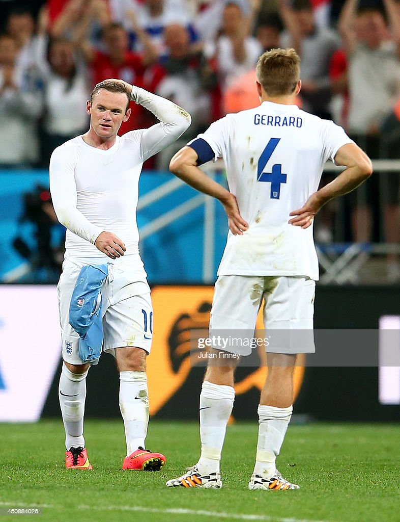 A dejected Wayne Rooney (L) and Steven Gerrard of England look on after being defeated by Uruguay 2-1 during the 2014 FIFA World Cup Brazil Group D match between Uruguay and England at Arena de Sao Paulo on June 19, 2014 in Sao Paulo, Brazil.
