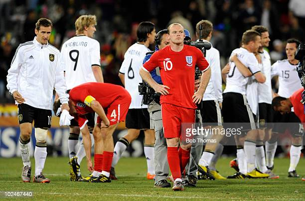 A dejected Wayne Rooney of England walks off the pitch after the finish of the 2010 FIFA World Cup South Africa Round of Sixteen match between...