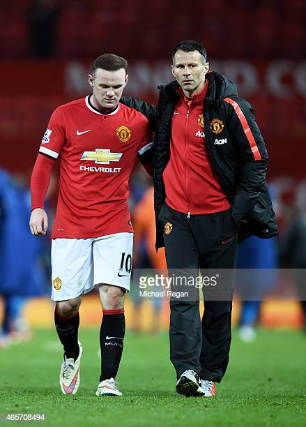 A dejected Wayne Rooney of Manchester United is consoled by Assistant Ryan Giggs of Manchester United following their team's 21 defeat during the FA...