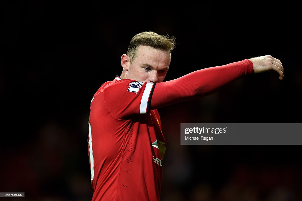 A dejected Wayne Rooney of Manchester United walks off the pitch following his team's 2-1 defeat during the FA Cup Quarter Final match between Manchester United and Arsenal at Old Trafford on March 9, 2015 in Manchester, England.