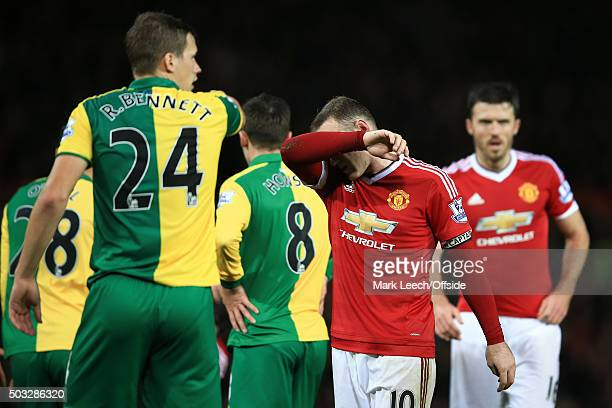 A dejected Wayne Rooney on his 500th appearance for Manchester United during the Barclays Premier League match between Manchester United and Norwich...