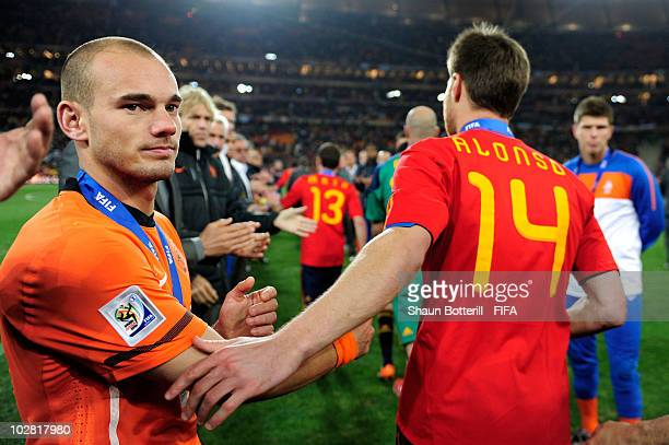 Dejected Wesley Sneijder of the Netherlands is consoled by Xabi Alonso of Spain during the 2010 FIFA World Cup South Africa Final match between...