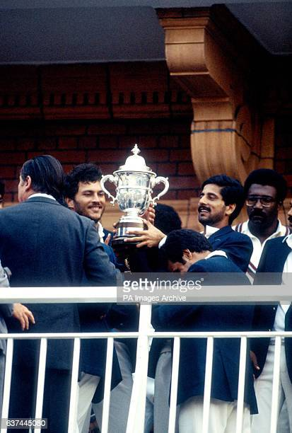 Dejected West Indies captain Clive Lloyd looks on as the India players celebrate with the Prudential World Cup