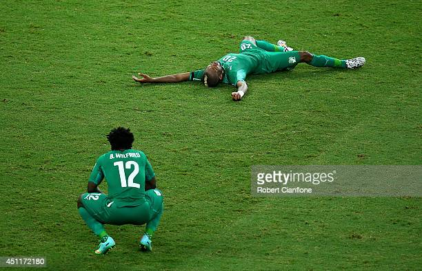 Dejected Wilfried Bony and Die Serey of the Ivory Coast react after being defeated by Greece 2-1 during the 2014 FIFA World Cup Brazil Group C match...