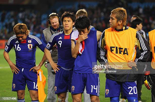 Dejected Yoshito Okubo, Shinji Okazaki, Kengo Nakamura and Junichi Inamoto of Japan after they lose a penalty shootout and go out of the tournament...