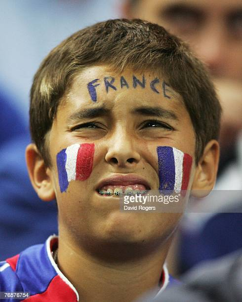 A dejected young french fan looks on as Argentina score the openiing try of the match during the opening match of the Rugby World Cup 2007 between...