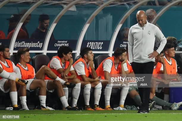 A dejected Zinedine Zidane the head coach / manager of Real Madrid during the International Champions Cup 2017 match between Real Madrid and FC...