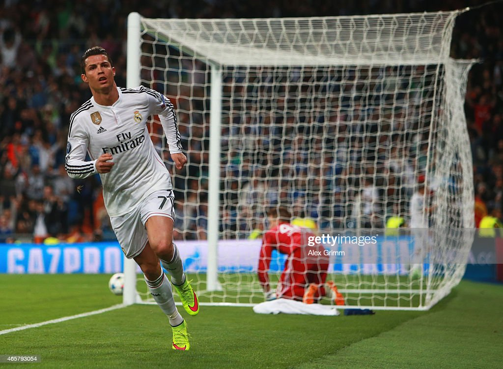 dejection for goalkeeper timon wellenreuther of schalke as cristiano ronaldo of real madrid cf celebrates as