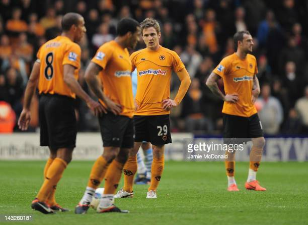 Dejection for Kevin Doyle of Wolves as Manchester City score there second goal during the Barclays Premier League match between Wolverhampton...