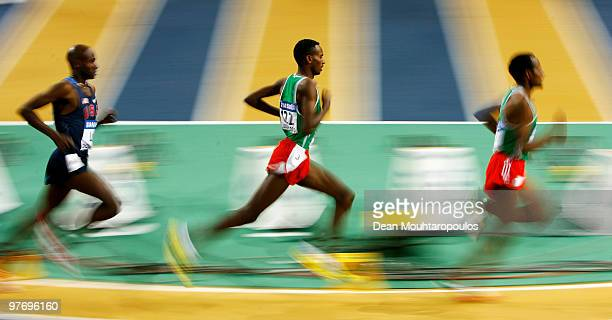Dejen Gebremeskel of Ethiopia competes in the Mens 3000m Final during Day 3 of the IAAF World Indoor Championships at the Aspire Dome on March 14,...