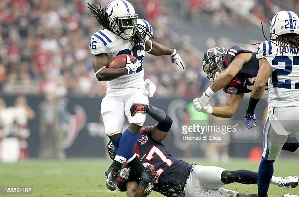 Deji Karem of the Indianapolis Colts is tackled by Quintin Demps of the Houston Texans on December 16, 2012 at Reliant Stadium in Houston, Texas.