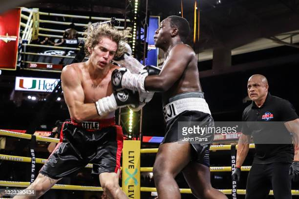 Deji Olatunji fights Vinnie Hacker during LivexLive's Social Gloves: Battle Of The Platforms PPV Livestream at Hard Rock Stadium on June 12, 2021 in...