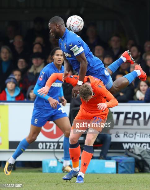 Deji Oshilaja of AFC Wimbledon wins a header over Aiden O'Brien of Millwall during the FA Cup Fifth Round match between AFC Wimbledon and Millwall at...