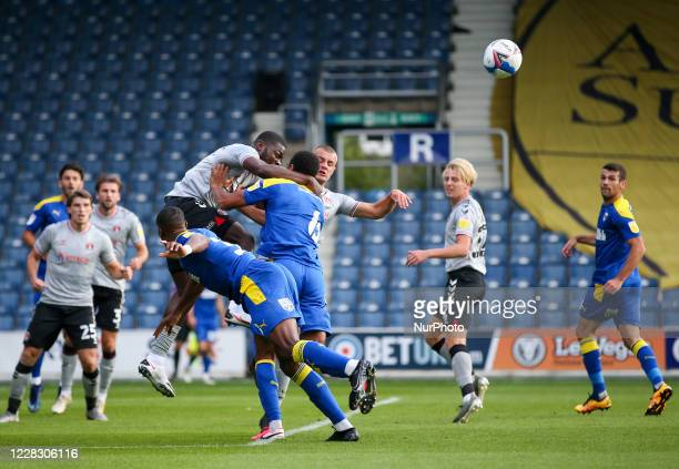 LONDON ENGLAND SEPT 1ST 2020 Deji Oshilaja of Charlton Athletic heads the ball clear during the EFL Trophy match between AFC Wimbledon and Charlton...