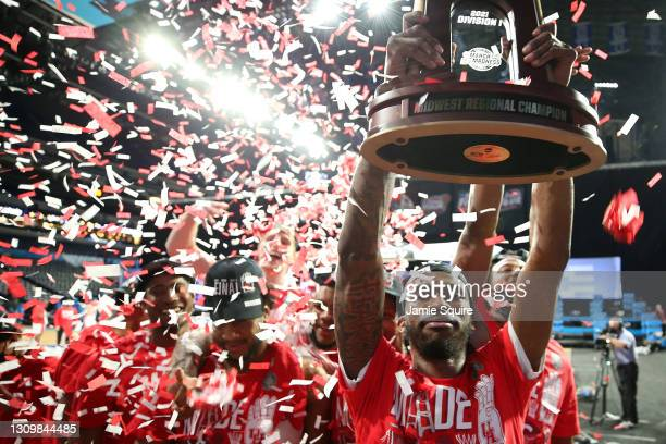 DeJon Jarreau of the Houston Cougars hoists the Midwest Regional Champion trophy after defeating the against the Oregon State Beavers in the Elite...