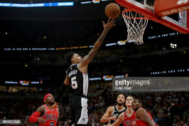 Dejounte Murray of the San Antonio Spurs attempts a shot in the fourth quarter against the Chicago Bulls at the United Center on October 21 2017 in...