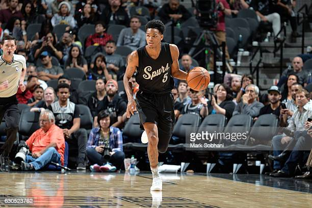 Dejounte Murray of the San Antonio Spurs brings the ball up court during the game against the Chicago Bulls on December 25 2016 at the ATT Center in...
