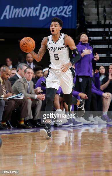 Dejounte Murray of the San Antonio Spurs brings the ball up the court against the Sacramento Kings on January 8 2018 at Golden 1 Center in Sacramento...