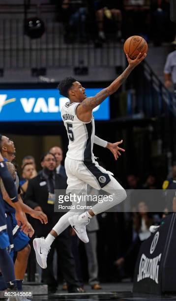 Dejounte Murray of the San Antonio Spurs drives for two against the Minnesota Timberwolves at ATT Center on October 18 2017 in San Antonio Texas NOTE...