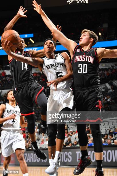 Dejounte Murray of the San Antonio Spurs drives to the basket against Kyle Wiltjer of the Houston Rockets during Game One of the Western Conference...